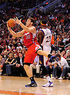 Apr. 1, 2011; Phoenix, AZ, USA; Los Angeles Clippers forward Blake Griffin (32) handles a loose ball against the Phoenix Suns forward Hakim Warrick (21) at the US Airways Center. The Suns defeated the Clippers 111-98. Mandatory Credit: Jennifer Stewart-US PRESSWIRE