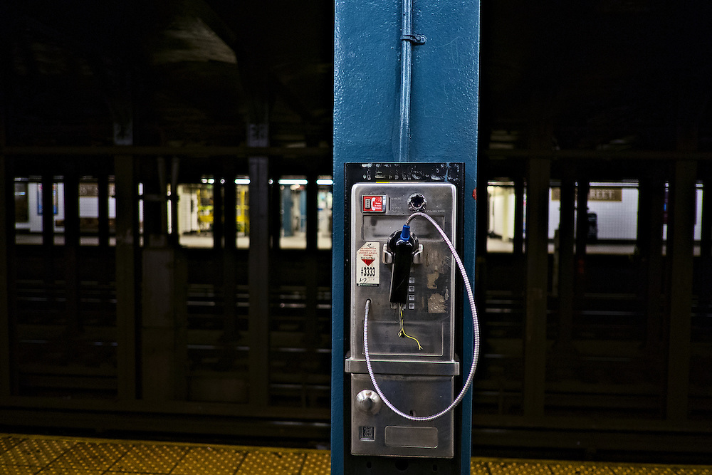 Broken pay telephone, 28th Street subway station, New York, NY, US