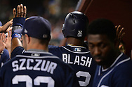 Sep 8, 2017; Phoenix, AZ, USA; San Diego Padres outfielder Jabari Blash (32) is congratulated in the dugout after scoring against the Arizona Diamondbacks in the fourth inning at Chase Field. Mandatory Credit: Jennifer Stewart-USA TODAY Sports