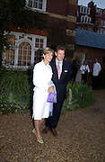 James and Julia Ogilvy, Cartier party, Chelsea Physic Garden. 19 May 2003. © Copyright Photograph by Dafydd Jones 66 Stockwell Park Rd. London SW9 0DA Tel 020 7733 0108 www.dafjones.com