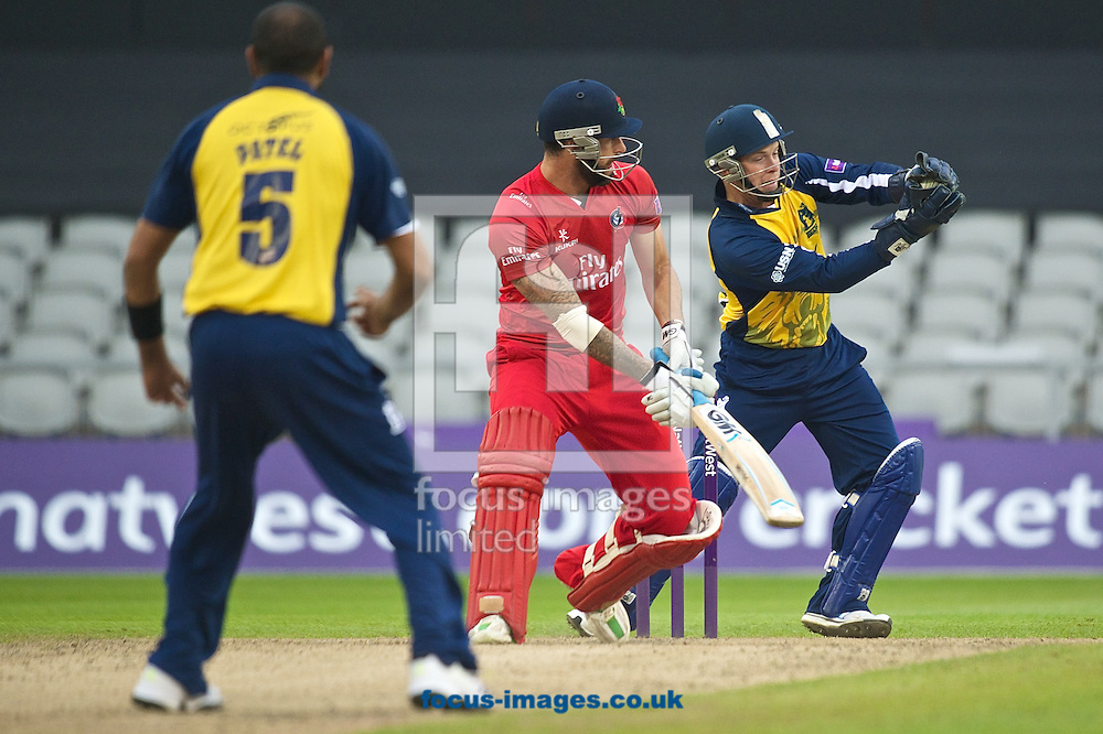 Jeetan Patel of Birmingham Bears,Jordan Clark of Lancashire Lightning and Tim Ambrose of Birmingham Bears during the Natwest T20 Blast match at Old Trafford Cricket Ground, Stretford<br /> Picture by Ian Wadkins/Focus Images Ltd +44 7877 568959<br /> 30/05/2014