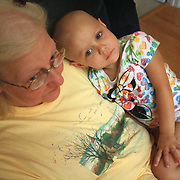 Holly Larue Frizzelle sits with her grandmother. On December 27, 2012 two year old Holly Larue Frizzelle was diagnosed with Acute Lymphoblastic Leukemia. What began as a stomach ache and visit to her regular pediatrician led to a hospital admission, transport to the University of North Carolina Children's Hospital, and more than two years of treatment.