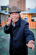 Portrait of a pensioner showing his Taekwondo skills close to Haeundae beach in Busan, South Korea.