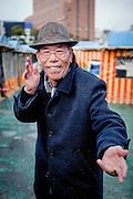 Portrait of a pensioner showing his Taekwondo skills close to Haeundae beach in Busan, South Korea.