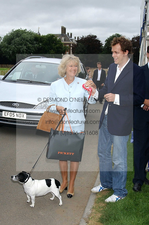 HRH The DUCHESS OF CORNWALL with her children TOM PARKER BOWLES and LAURA PARKER BOWLESat the 3rd annual Macmillan Dog Day in aid of Macmillan Cancer Relief held at Royal Hospital Chelsea, London SW3 on 5th July 2005.<br />