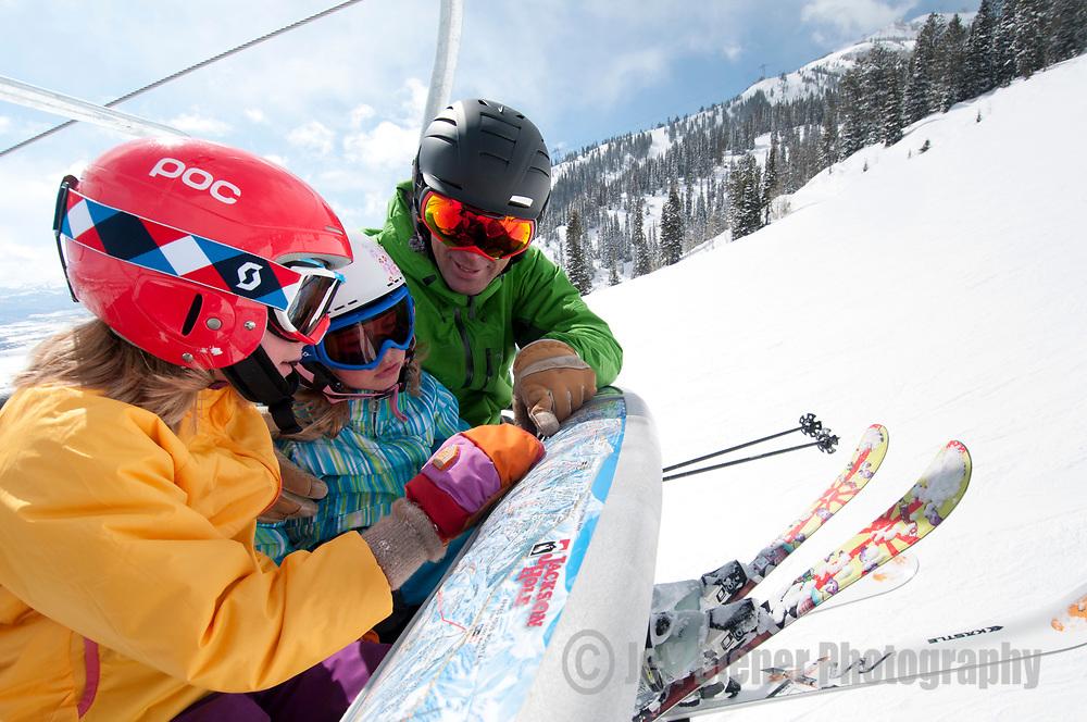 A family skis at Jackson Hole Mountain Resort, Jackson Hole, Wyoming.