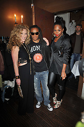 Left to right, Footballer EDGAR DAVIDS, KELLY HOPPEN and JESSIE B at a party to celebrate the publication of her new book - Kelly Hoppen: Ideas, held at Beach Blanket Babylon, 45 Ledbury Road, London W11 on 4th April 2011.