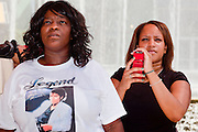 Jul 7, 2009 -- GLENDALE, AZ: DEON TILLMAN, left, and JENNIFER PREYER watch the memorial service for Michael Jackson in Glendale, AZ. About 35 people came to Westgate Center, a shopping and dining complex in Glendale, a suburb of Phoenix, AZ, to watch the memorial service for Michael Jackson. The service was simulcast live from the Staples Center in Los Angeles on jumbotrons around the complex. Photo by Jack Kurtz