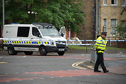 June 2, 2017 - Manchester, England, United Kingdom - A police officer guards the cordoned off area of a street, where part of the investigation in to the Manchester Arena explosion is taking place, in Manchester, United Kingdom, Friday, June 02, 2017. Greater Manchester Police are treating the explosion after the Ariana Grande concert, which took place on 05/22/2017 at Manchester Arena, as a terrorist attack. (Credit Image: © Jonathan Nicholson/NurPhoto via ZUMA Press)