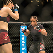 Weili Zhang (maroon trunks) defeated Danielle Taylor (black trunks) in a starweight bout at UFC 227 held at the Staples Center in Los Angeles on August 4, 2018. Photo by Todd Bigelow for ESPN.