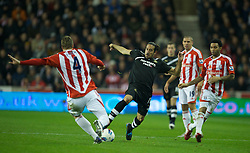 STOKE-ON-TRENT, ENGLAND - Monday, October 31, 2011: Stoke City's Robert Huth in action against Newcastle United's Jonas Gutierrez during the Premiership match at the Britannia Stadium. (Pic by David Rawcliffe/Propaganda)
