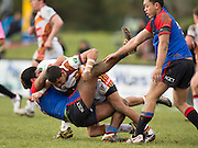 UCZ's Wiremu Wirihana is tackled by NSW's Jayden Connors during the rugby league match between Upper Central Zone U18 and NSW Country U18, at Puketawhero Park, Rotorua, New Zealand, Saturday 13 July 2013.  Photo: Stephen Barker/photosport.co.nz