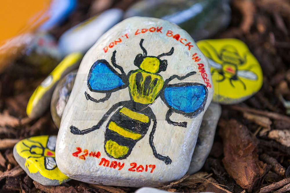 © Licensed to London News Pictures. 22/05/2018. Manchester UK. Picture shows a painted Bee pebble left in St Ann's Square in Manchester this morning to mark the first anniversary of the Manchester Arena bombing. 22 people died when Salman Abedi detonated a bomb at an Ariana Grande concert. Photo credit: Andrew McCaren/LNP