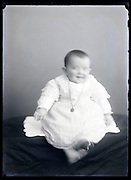 circa 1930s blurry toddler studio portrait