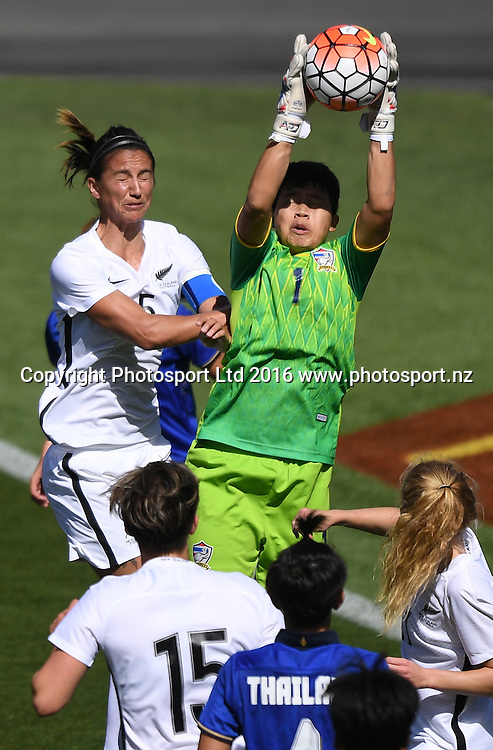 Thailand goalkeeper Waraporn Boonsing goes high for the ball.<br />