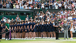 LONDON, ENGLAND - Saturday, July 9, 2016:  Angelique Kerber (GER) is being interviewed by Sue Barker next to the row of ball boys and girls after receiving her trophy for runner up after the Ladies' Singles - Final match on day thirteen of the Wimbledon Lawn Tennis Championships at the All England Lawn Tennis and Croquet Club. (Pic by Kirsten Holst/Propaganda)