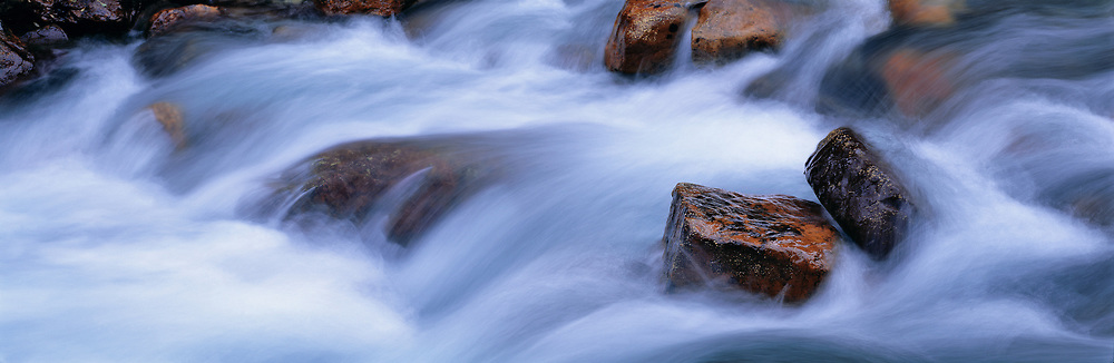 Moraine Creek turmbles over colorful rocks in Banff National Park, Alberta Canada. ©Ric Ergenbright