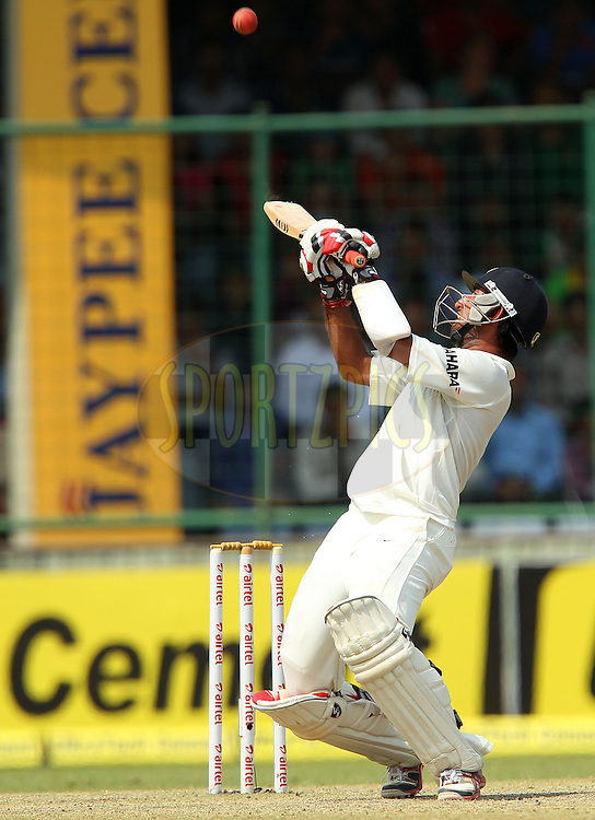Cheteshwar Pujara of India flips the ball over the top for four during day 3 of the 4th Test Match between India and Australia held at the Feroz Shah Kotla stadium in Delhi on the 24th March 2013..Photo by Ron Gaunt/BCCI/SPORTZPICS ..Use of this image is subject to the terms and conditions as outlined by the BCCI. These terms can be found by following this link:..http://www.sportzpics.co.za/image/I0000SoRagM2cIEc