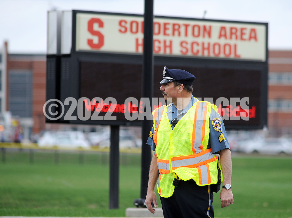 SOUDERTON, PA - APRIL 14:  A police officer stands guard outside the entrance after a bomb threat forced the evacuation of Souderton High School April 14, 2014 in Souderton, Pennsylvania. (Photo by William Thomas Cain/Cain Images)