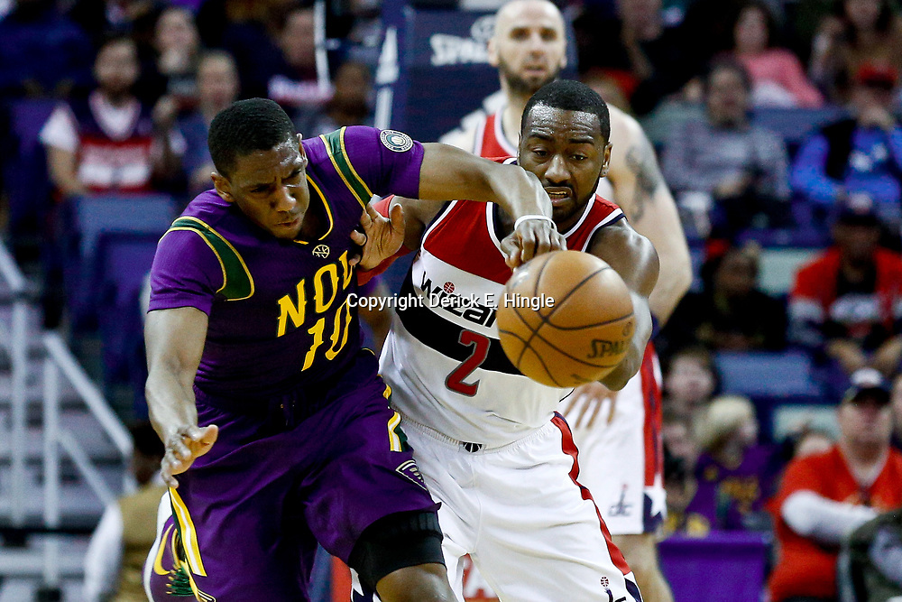 Jan 29, 2017; New Orleans, LA, USA; Washington Wizards guard John Wall (2) and New Orleans Pelicans guard Langston Galloway (10) collide while scrambling for a loose ball during the second quarter of a game at the Smoothie King Center. Mandatory Credit: Derick E. Hingle-USA TODAY Sports
