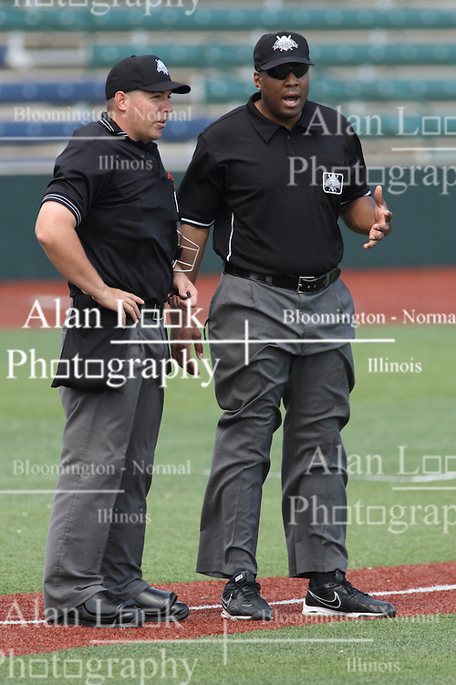 07 June 2015:  Umpires David Fields and Joe Harris during a Frontier League Baseball game between the Southern Illinois Miners and the Normal CornBelters at Corn Crib Stadium on the campus of Heartland Community College in Normal Illinois