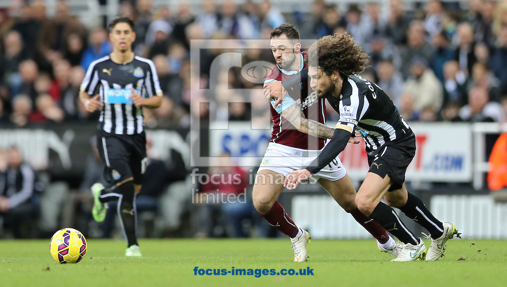 Fabricio Coloccini (r) of Newcastle United and Danny Ings of Burnley during the Barclays Premier League match at St. James's Park, Newcastle<br /> Picture by Simon Moore/Focus Images Ltd 07807 671782<br /> 01/01/2015