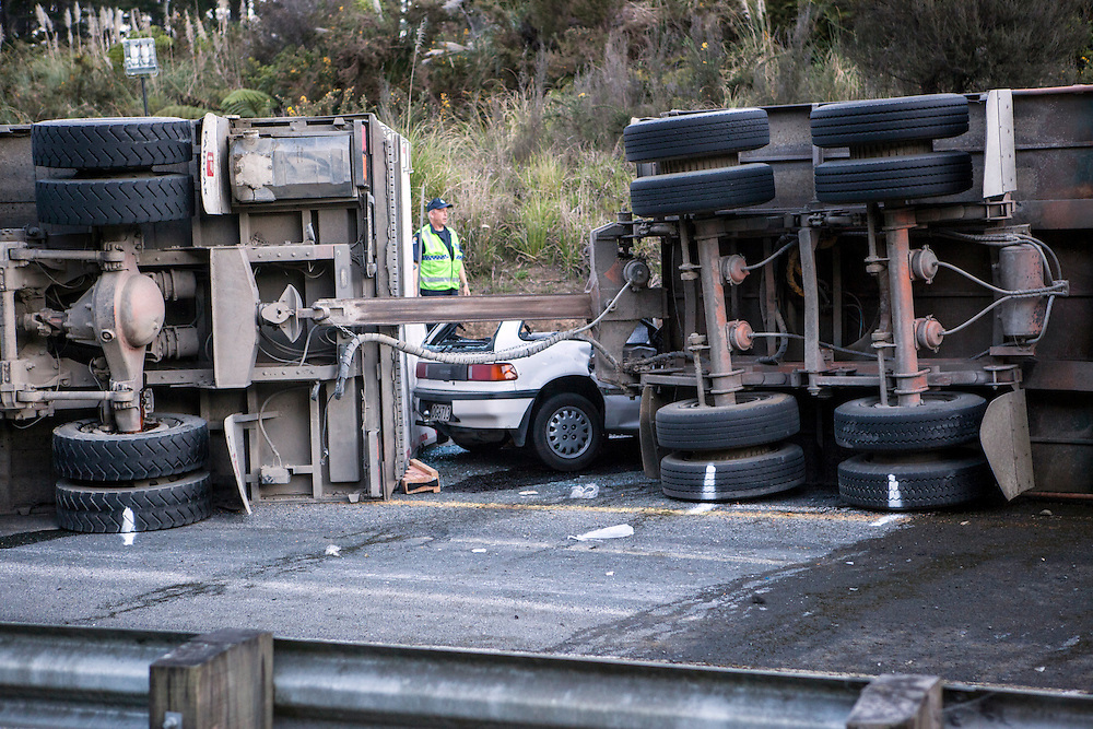 A truck and trailer unit carrying cattle tipped over on a bend landing on a vehicle causing serious injuries on SH1 north of Wellsford, New Zealand, Monday, October 07, 2013. Credit:SNPA / Bradley Ambrose