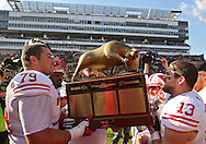 November 02 2013: Wisconsin Badgers offensive linesman Ryan Groy (79) and Wisconsin Badgers linebacker Conor O'Neill (13) hold up the Heartland Trophy following the NCAA football game between the Wisconsin Badgers and the Iowa Hawkeyes at Kinnick Stadium in Iowa City, Iowa on November 2, 2013. Wisconsin defeated Iowa 28-9.