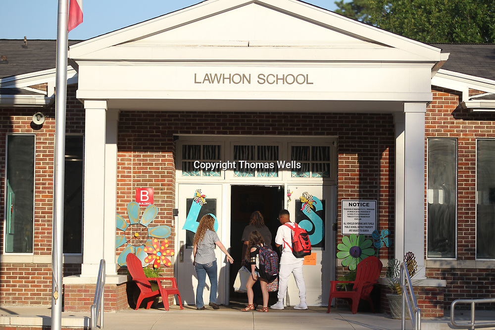 Parents and students make their into Lawhon Elementary School for the first day of school on Thursday.