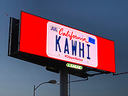 """General overall view of billboard promoting the recruitment Toronto Raptors free agent forward Kawhi Leonard to sign with the LA Clippers along the Interstate 5 freeway, Monday, June 24, 2019, in the Los Angeles suburb of Downey, Calif.  The advertisement features a California vanity personalized license plate reading """"KAWHI"""" with the hashtag #ClipperNation."""
