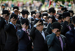 © London News Pictures. 14/05/2017. London, UK. Cavalrymen 'doff' their hats during the parade, as thousands of serving and former Cavalrymen, many wearing bowler hats and carrying closed umbrellas, take part in Combined Cavalry Old Comrades Association Annual Parade in Hyde Park, London. A service of remembrance is held to honour Cavalry and other troops who have fallen in the service of their country since the first world war. Photo credit: Ben Cawthra/LNP