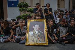 October 14, 2016 - Bangkok, Bangkok, Thailand - Thai Royalists and well-wishers gather inside Siriraj Hospital while carrying portraits of the King to await the funeral procession of Thailand's King Bhumibol Adulyadej in Bangkok, Thailand on October 14, 2016. Thai King Bhumibol Adulyadej was the world's longest reigning monarch and died at the age of 88 after a long illness since several years, he was the most unifying symbol for Thai people and leaving behind him a divided country under military control. Prime Minister Prayut Chan-o-Cha made a statement that Thailand would have one year period of mourning for HM the King. (Credit Image: © Guillaume Payen/NurPhoto via ZUMA Press)