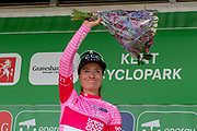 Marianne Vos (NED) riding for CCC-Liv on the podium with her Breast Cancer Care jersey and flowers after stage 2 of the OVO Energy Women's Tour 2019 at Cyclopark, Gravesend, United Kingdom on 11 June 2019.