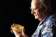"Colombo, Sri Lanka.Sir Arthur C. Clarke holds a DVD copy of the movie 2001: A Space Odyssey. Clarke wrote, ""Any sufficiently advanced technology is indistinguishable from magic."" Referring to the DVD in his hand, he said, ""If I were able to give Thomas Edison this disc, he would have no idea of what it was or how it worked. It would be magic."" Sir Arthur is best known for the book 2001: A Space Odyssey. MODEL RELEASED"