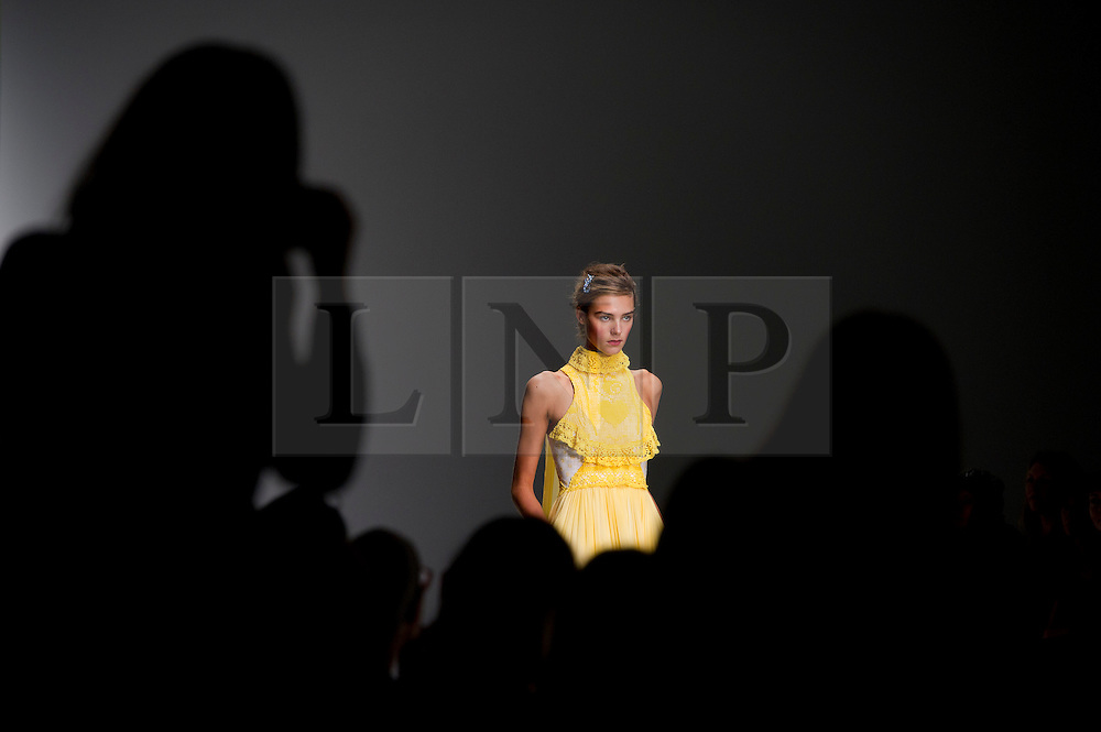 © London News Pictures. 13/09/2013. London, UK.  A model walks the runway at the Bora Aksu show at London Fashion Week Spring/Summer 2014. Photo credit : Ben Cawthra/LNP