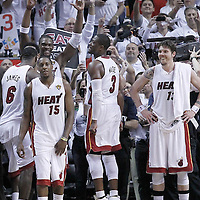 21 June 2012: Miami Heat small forward LeBron James (6), Miami Heat power forward Chris Bosh (1) Miami Heat point guard Mario Chalmers (15), Miami Heat shooting guard Dwyane Wade (3) and Miami Heat shooting guard Mike Miller (13) celebrate during the Miami Heat 121-106 victory over the Oklahoma City Thunder, in Game 5 of the 2012 NBA Finals, at the AmericanAirlinesArena, Miami, Florida, USA. The Miami Heat wins the series 4-1.