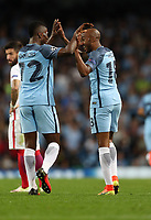 Football - 2016 / 2017 Champions League - Qualifying Play-Off, Second Leg: Manchester City [5] vs. Steaua Bucharest [0]<br /> <br /> Fabian Delph of Manchester City celebrates with Kelechi Iheanacho during the match, at the Ethihad Stadium.<br /> <br /> COLORSPORT/LYNNE CAMERON