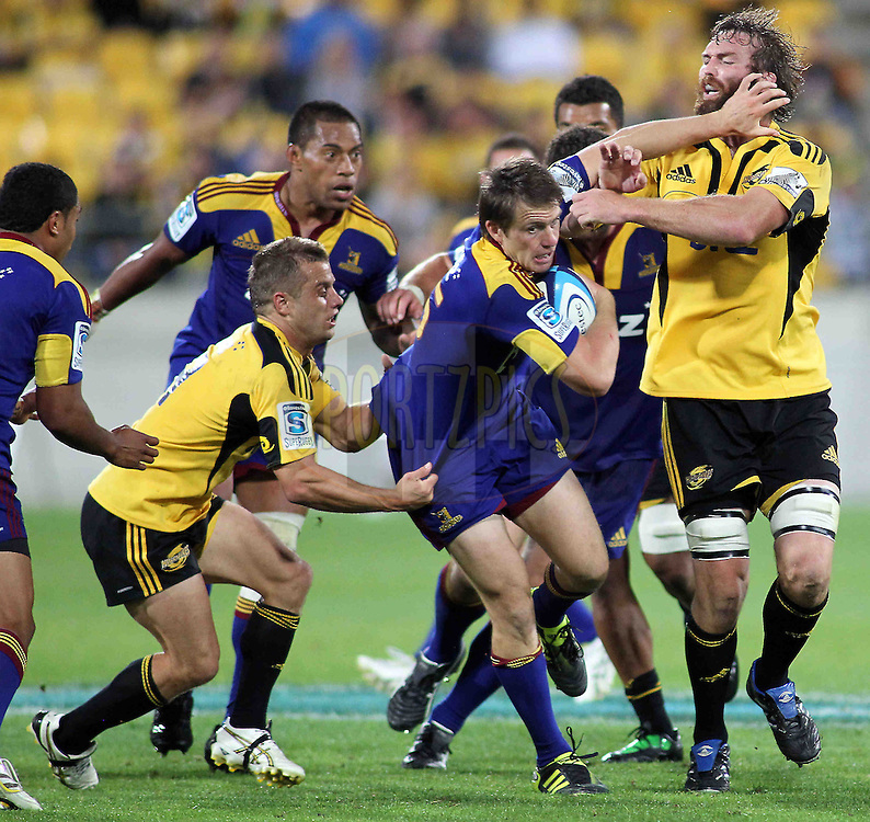 Highlanders Ben Smith fends off Hurricanes Jason Eaton. Super 15 - Hurricanes v Highlanders, Westpac stadium, Wellington, 18 February 2011. PHOTO: Grant Down / photosport.co.nz