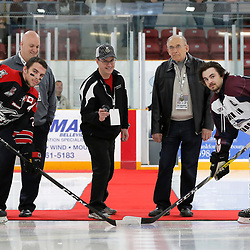 "TRENTON, ON  - MAY 2,  2017: Canadian Junior Hockey League, Central Canadian Jr. ""A"" Championship. The Dudley Hewitt Cup. Game 1 between Dryden GM Ice Dogs and the Georgetown Raiders. Ceremony Puck Drop with Miguel Drouin, Paul Leskw and Eric Light from Nevco Scoreboards.  Team Captains Derek McPhail #21 of the Dryden GM Ice Dogs and Josh Dickinson #28 of the Georgetown Raiders<br /> (Photo by Amy Deroche / OJHL Images)"
