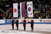 KELOWNA, BC - OCTOBER 26: Ladies flags during medal ceremonies of Skate Canada International held at Prospera Place on October 26, 2019 in Kelowna, Canada. (Photo by Marissa Baecker/Shoot the Breeze)