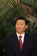 Xi Jinping, newly appointed member of the Chinese Communist Party Politburo Standing Committee, is introduced in the Greal Hall of the People in Beijing,    China, on Monday, Oct. 22, 2007.    China's ruling Communist Party named four new members to its top executive body today, making them potential successors to President Hu Jintao, who was elected to a second five-year term as party chief and head of the military.