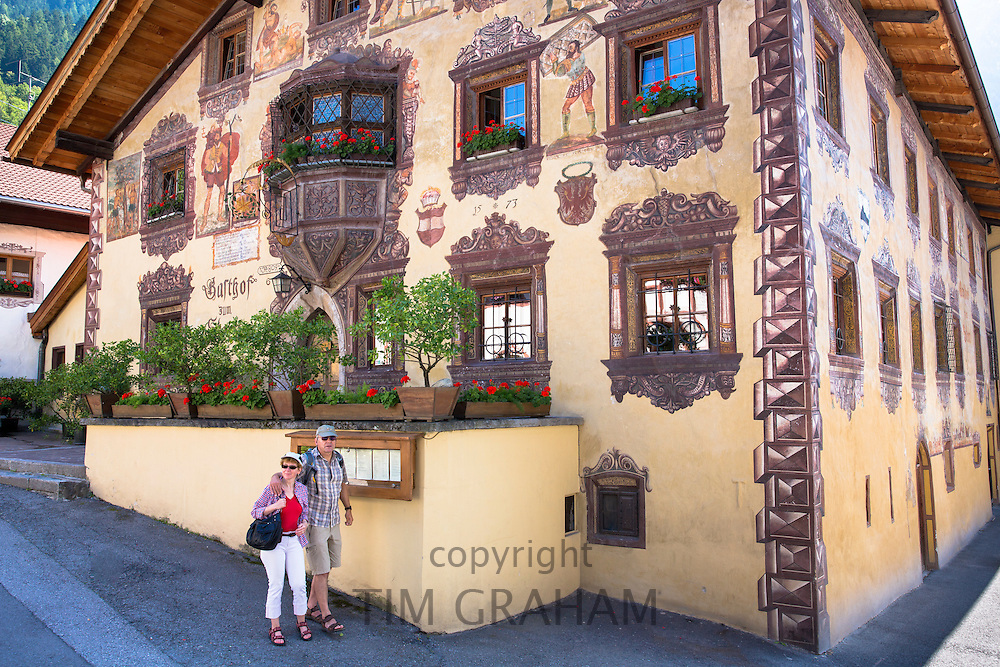 Tourists passing Gasthof Stern hotel in Kirchweg in the old part of the town of Oetz in the Tyrol, Austria