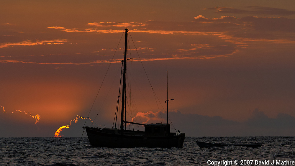 Sunset and Sailboat off Kona Beach, Big Island Hawaii. Image taken with Nikon D2xs and 80-400 mm VR lens (ISO 100, 400 mm, f/8, 1/200 sec).