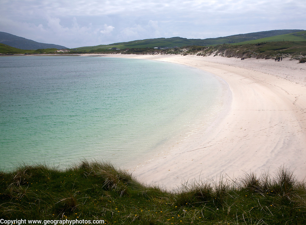Sandy beach and aquamarine sea at Vatersay Bay, Barra, Outer Hebrides, Scotland, UK