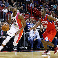 21 January 2012: Miami Heat small forward James Jones (22) drives past Philadelphia Sixers guard Jodie Meeks (20) during the Miami Heat 113-92 victory over the Philadelphia Sixers at the AmericanAirlines Arena, Miami, Florida, USA.