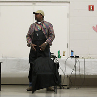"Lezarus Sykes waits to give his first haircut for patients at the State Hospital as part of a ""Love Yourself Day""."