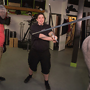 PORTLAND, Maine  12/15/18 -- Seth Robinson instructs two athletes in the use of historical longswords as part of a HEMA (Historical European Martial Arts) practice in Portland on Saturday. Robinson has trained for nine years in this martial art and has also studied other martial arts including Kung Fu. The group meets weekly in Portland and can be reached at http://www.resurgamhema.com .  <br /> Photo by Roger S. Duncan for The Forecaster.