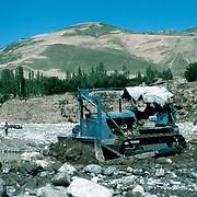 21 May 1976<br /> Bulldozer picking up huge boulders.