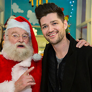 NO REPRO FEE<br /> 25/12/2014<br /> Special visitors on Christmas Day in Temple Street Children&rsquo;s Hospital<br /> Danny from the Script makes little kid&rsquo;s Christmas with hospital visit.<br /> Pictured here are Santa Clause and Danny from The Script.<br /> Danny O&rsquo;Donoghue showed a heart of gold when he turned up at Temple Street&rsquo;s Children&rsquo;s Hospital on Christmas Day. The Script&rsquo;s frontman spent a number of hours on Christmas morning visiting children at their bedside along with Santa, the Lord Mayo.&nbsp;Last year, almost 400 children were cared for in Temple Street on Christmas Eve and Christmas Day &amp; a visit from Danny helped bring the magic of Christmas to Temple Street for the children and babies who are too ill or weak to make it home. Danny said of his work with Temple Street &ldquo;It&rsquo;s amazing to be involved with Temple Street, it&rsquo;s the greatest hospital on the planet. It&rsquo;s really humbling to see the children, families, doctors and nurses in Temple Street; they are all true superheroes.&quot;<br /> Pic: Alan Rowlette Photography<br /> -ENDS-