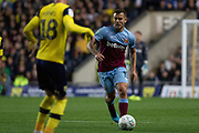 Jack Wilshire (19) of West Ham United takes on Mark Sykes (18) of Oxford United during the EFL Cup match between Oxford United and West Ham United at the Kassam Stadium, Oxford, England on 25 September 2019.